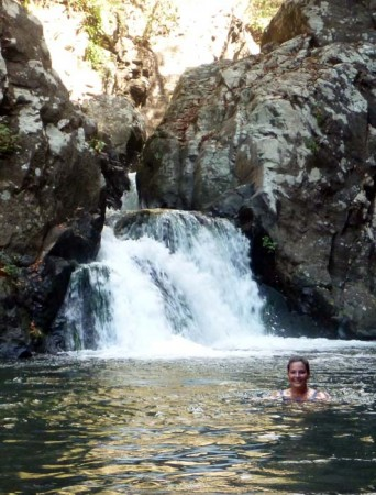 Leah swimming in the waterfall