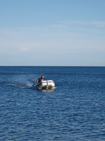 Jon in the dinghy