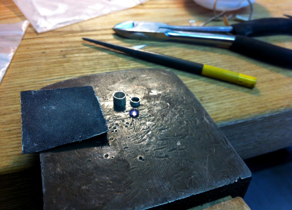 "Metalsmithing - This is the ""sapphire"" I melted (was apparently glass)"