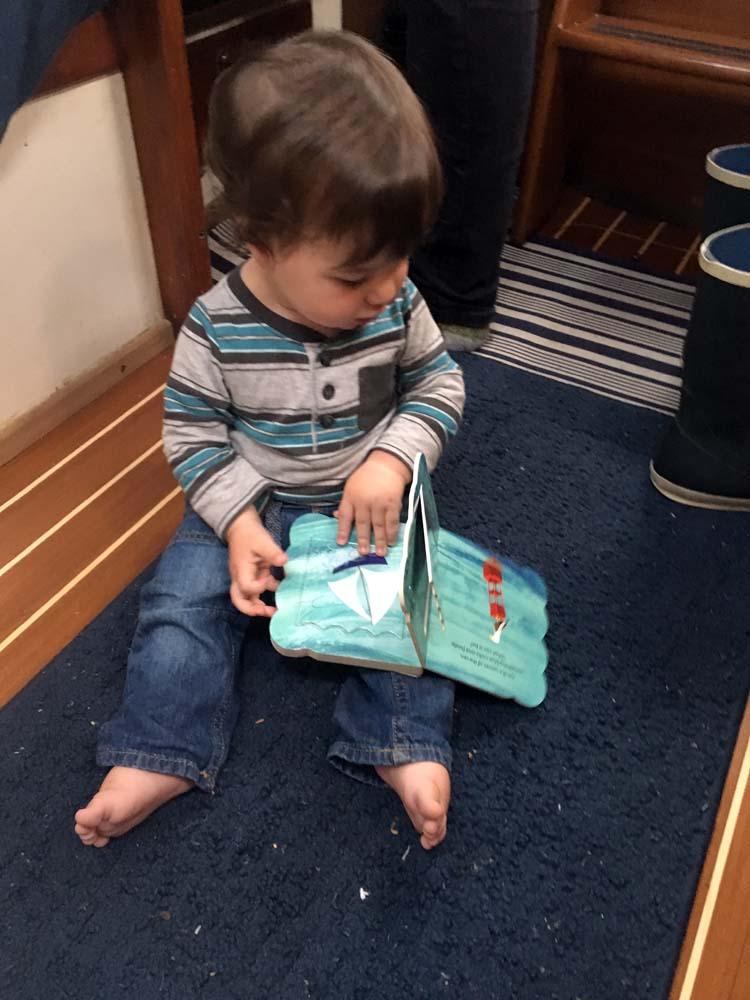 Boat baby reading his boat book